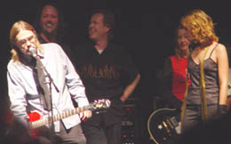 Moe accepts the guitar for the 2003 CASBY Lifetime Achievement Award.  (l.-r.): Moe, Brad, Dave, Kris, Renee.
