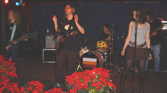 (l.-r.) Kris, Moe, Dave, Renee and Brad.  And some lovely poinsettias.  12/28.  Photo by Stephen A. Gazzola